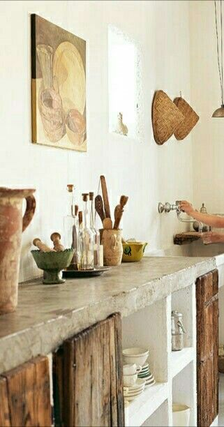 Primitive Style Kitchen: Colored Concrete Top....much warmer feel: Stucco box Kitchen cabs.Vintage Lumber/ recycled Doors
