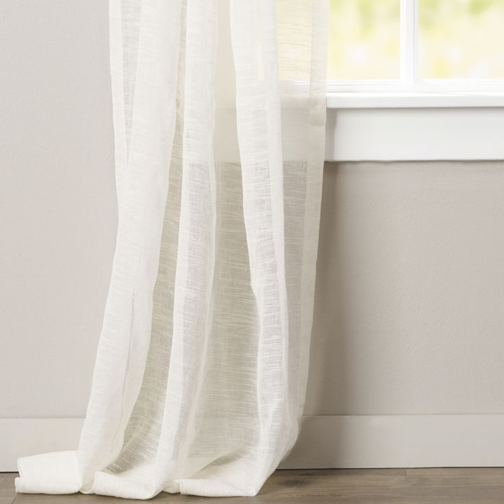 A neutral hue pairs with a light-filtering design to round out this open weave single curtain panel for a timeless addition to your decor collection. Add it to the living room to complement a coastal arrangement lovely so you can frame your view to the sea or simply let the sunlight stream in. Its understated silhouette is equally perfectly in both formal and casual aesthetics. Pair it with a woven jute rug for a touch of texture or match it with a shimmering wall mirror for a dynamic…