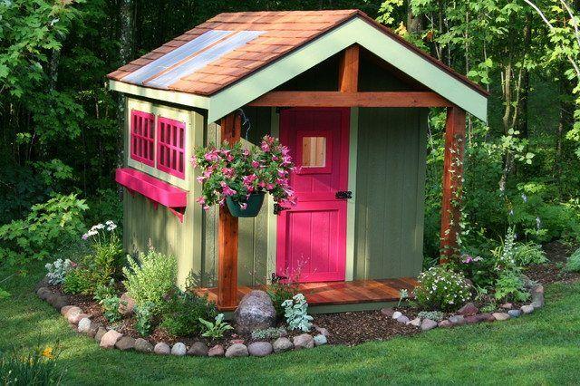 Gartenhaus Holz rosa Fensterrahmen Türen Hängetopf Flusssteine