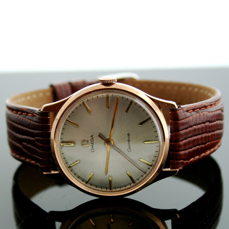 Vintage Omega Geneve 18K Rose Gold Watch with Leather Strap. $4,500.00, via SITFineJewelry Etsy.