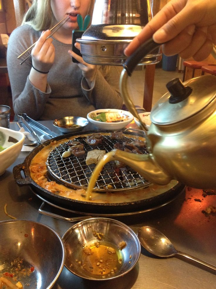"""SEOUL, Korea-  This is called """"egg rimmed galbi"""".. That yellow stuff being poured is eggs that will be cooked along the edges of the grill, where you cook your beef. So good!"""
