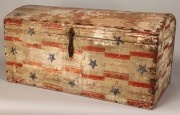 Patriotic folk art decorated trunk with Federal Eagle on dome trunk, border of stars and red stripes, red ribbon and blue star decoration around front and sides of trunk. Mid to late 19th century