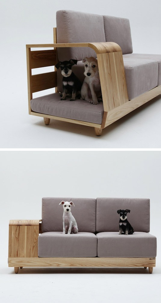 Cozy doggy bed built into couch.
