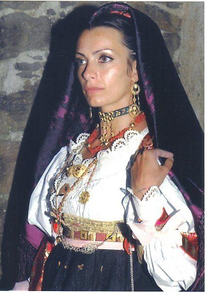 Traditional dress in Sardinia, #Italy #photo