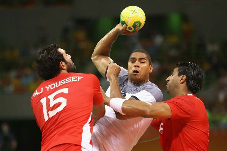 RIO DE JANEIRO, BRAZIL - AUGUST 07: Daniel Narcisse of France is blocked during the Mens Preliminary Group A match between France and Tunisia at the Future Arena on Day 2 of the Rio 2016 Olympic Games at the Future Arena on August 7, 2016 in Rio de Janeiro, Brazil. (Photo by Phil Walter/Getty Images)