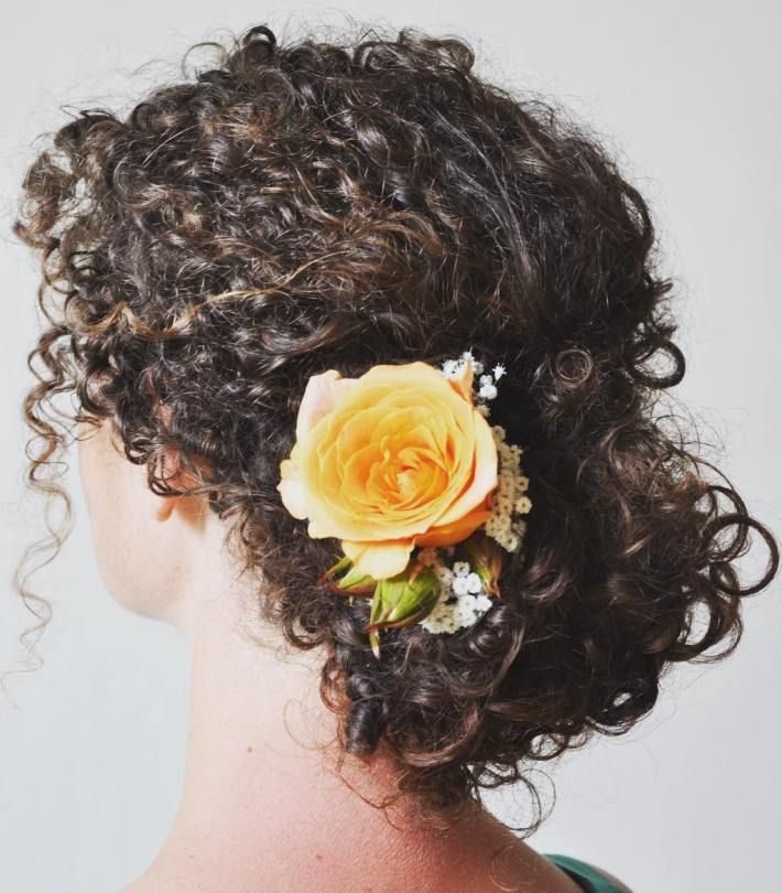 Low Updo With A Rose For Natural Hair