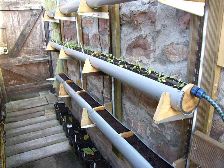 20 best diy gutter gardens images on pinterest gutter for Rain gutter planter box