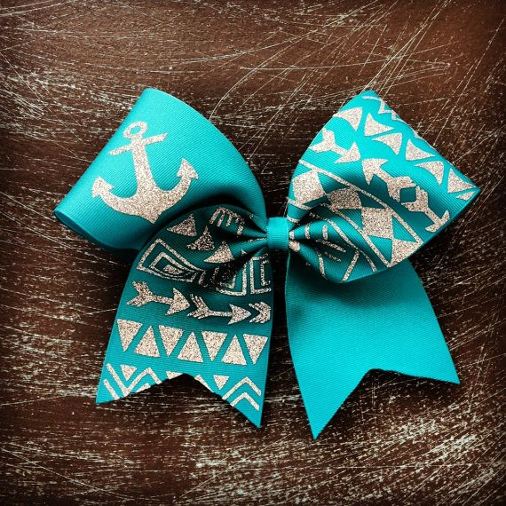 Buy teal tribal print cheer bow by bragaboutitcheerbows. Explore more products on http://bragaboutitcheerbows.etsy.com
