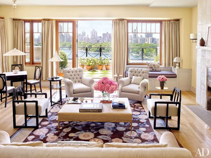 Art Deco rug from Paris anchors this light-filled Manhattan livingroom with river view, window seat and corner table