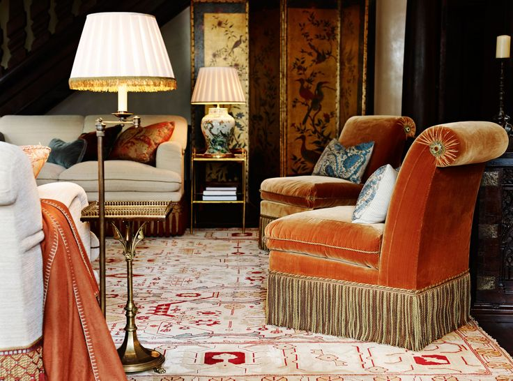 Scroll back chairs uphosltered in orange velvet with bullion fringe