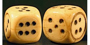 Seen here is a set of dice that was used in several gambling games in the West. They are hollow and rounded square shape. They were typically hand made by a local craftsman. Today's dice are perfectly cubes and they are bright white.