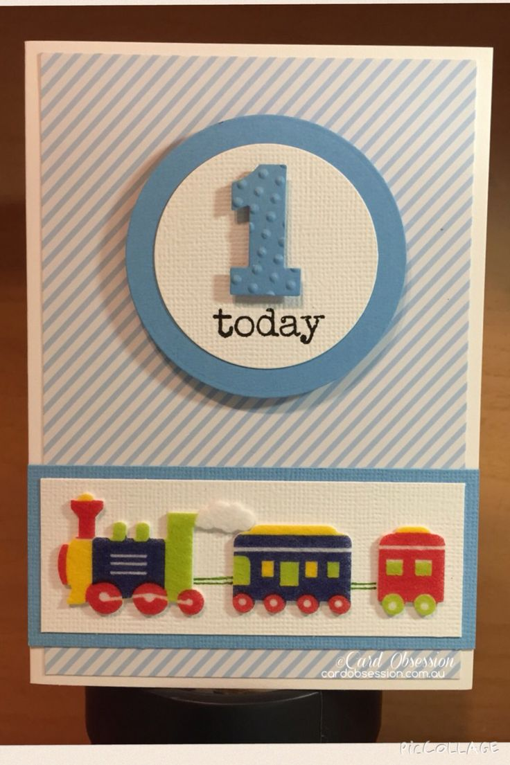 1st birthday card. White and blue with train embellishment. Can be made for any age.