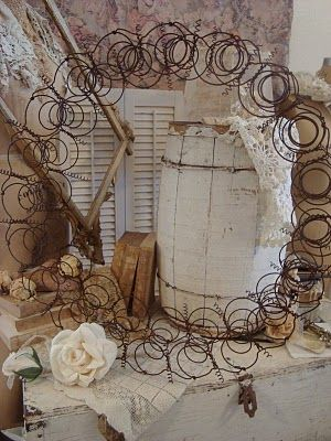 Magical Bed Spring Wreath--These fantastic and one-of-a-kind wreaths can be purchased or ordered in quantities at the Quinlan Fleamarket in East Texas. Jo's phone number is 903-456-4129. Give her a call and put her husband to work making these awesome wreaths