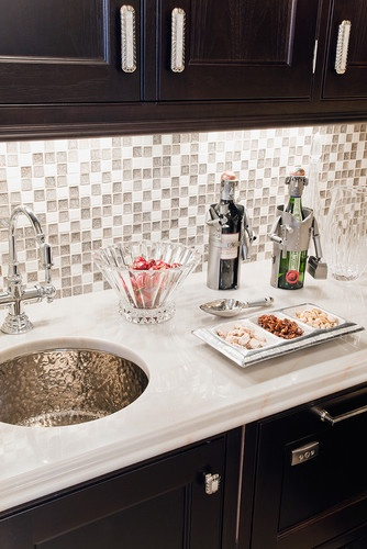 White marble countertops, hammered finish sink, and sparkley mosaic backsplash on a wet bar. I'm also digging the knobs, pulls, and accessories. Eclectic AND elegant!