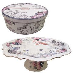 Beautifully ornate cake stand from The Aviary collection at Disaster Designs, complete with a shimmering gold trim. It is presented in a gorgeous box, which makes it an ideal gift for someone - or the perfect addition to your kitchen! 31cm across.