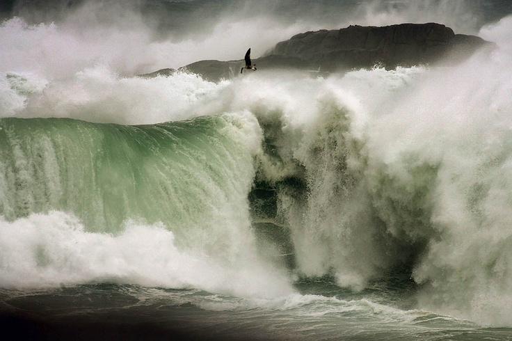 A Coruna, Spain — A huge wave breaks over rocks in A Coruna, in Galicia. Strong winds prompted authorities to declare a red alert at sea and yellow on land. Fishing activity came to a halt as ships remained moored in port due to the weather bad conditions.    PHOTOGRAPH BY: CABALAR / EPA