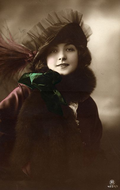 Old tinted photo postcards of ladies wearing hats and furs (or both...especially with muffs), AND of romantic couples are my favorite!!!!  LOVE this one!