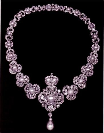 """Queen Victoria Golden Jubilee Necklace - In 1887, the """"Women of the British Empire"""" each gave between a penny and a pound to provide a celebratory memorial for the Queen's fifty years on the throne. The design is of diamond trefoils, each with a pearl centre. The centre piece is a quatrefoil of diamonds with pearl centre and drop pendant. Surmounting it is a pearl/ diamond crown. It is possible to detach the centre piece wear as a pendant. Queen Victoria left the necklace to the Crown in…"""