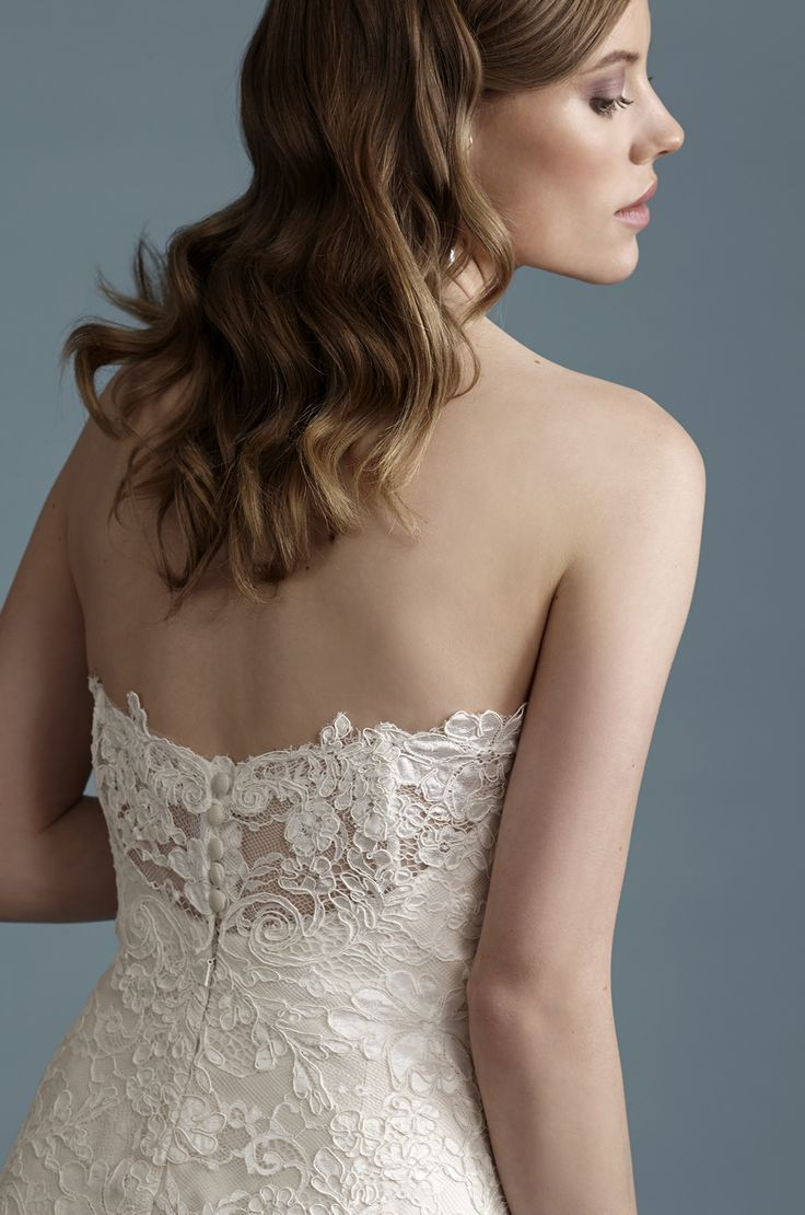 Barbra Allin 8033 - This all-over lace gown has a beautiful fitted silhouette and peek-a-boo back, It's made in house at Becker's Bridals in our Toronto Studio.