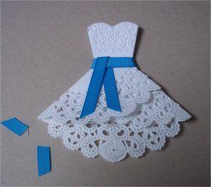http://paperpaws.blogspot.com/2012/05/doily-dress-folds-tutorial.html