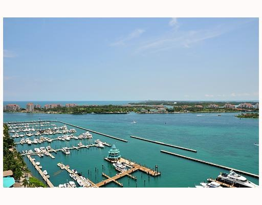 SOUTH BEACH CHIC! Unit w/180 degree Views of MB Marina, Fisher Island& the Ocean beyond.Originally a 3 Bed smartly reconfigured into 2 XL Beds/3 Baths.Gorgeous Wide plank Oak Flooring throughout.Spacious Terrace w/Spanish black marble.Bang  home theatre Sound Sys thruout. Sleek Kitchen w/European Cabinetry,Miele appliances& Corian countertops.