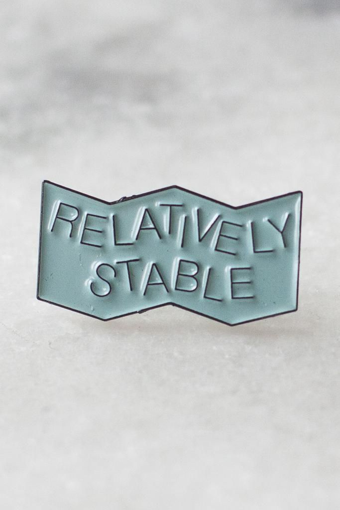 """We're relatively stable and tentatively able to say for certain whether this uncertainty is for sure. 1"""" wide lapel pin in matte black metal with pale blue soft enamel filling.Created as an officialcollaboration with one of our favourite bands, American Football. Get more info on the bandhere:http://americanfootballmusic.com."""