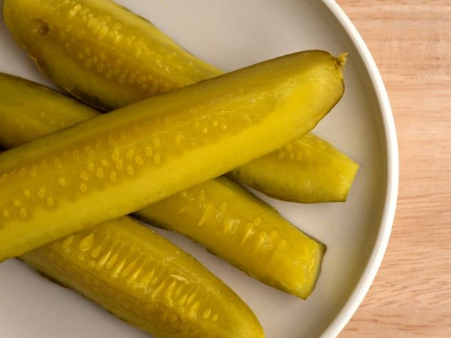 A recipe for Ball Sweet Pickle Spears made with pickling cucumbers, sugar, white vinegar, canning salt, celery salt, turmeric, mustard