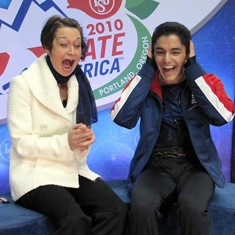 Armin Mahbanoozadeh and coach Priscilla Hill go equally bananas as the skater's bronze-medal scores are announced at 2010 Skate America.