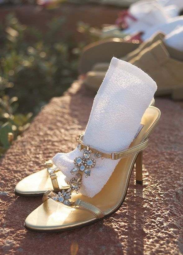 10 Ideas For Beach Weddings: #7. Shoe station. Excuse us for repeating ourselves, but sand and high heels just don't mix. Set up a shoe station where guests can kick off their shoes and feel the sand between their toes.