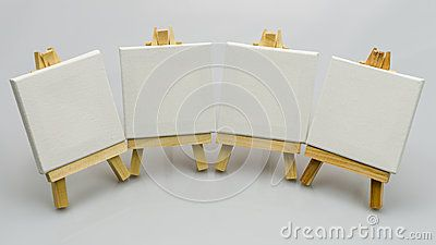 A four  small easels  ready to paint a picture
