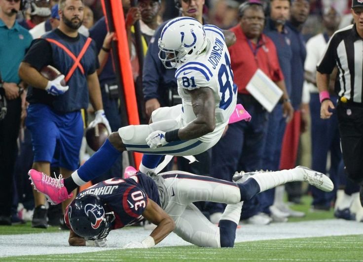 Indianapolis Colts' Andre Johnson (81) is upended by - Indianapolis Colts' Andre Johnson (81) is upended by Houston Texans' Kevin Johnson (30) during the first half of an NFL football game Thursday, Oct. 8, 2015, in Houston. (AP Photo/George Bridges)