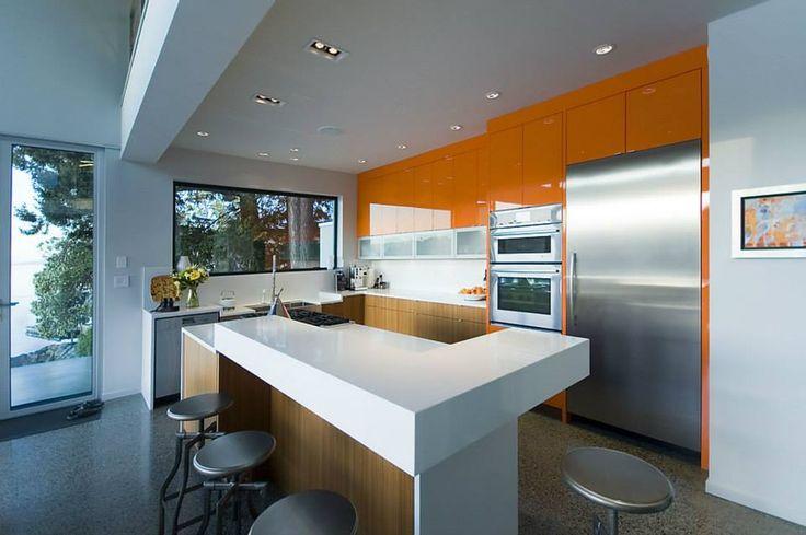 Kitchen countertops with island in Aurora Snow Hanstone. Interior Design by Creative Spaciz