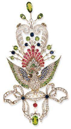 AN UNUSUAL ANTIQUE DIAMOND AND GEM-SET PEACOCK BROOCH Centering upon an old European-cut diamond peacock with pavé-set demantoid garnet head enhanced by circular-cut ruby crest and cabochon ruby accent eye...circa 1890