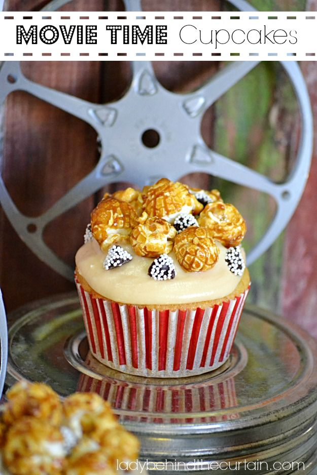 A vanilla cupcake with caramel butter frosting topped with fun movie treats.