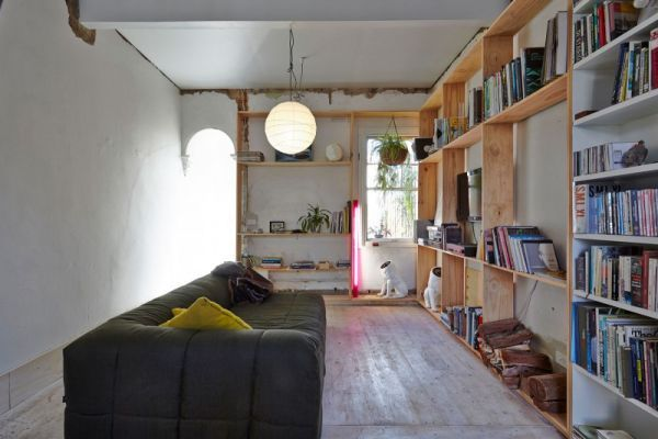 A Narrow Home With A Small Courtyard