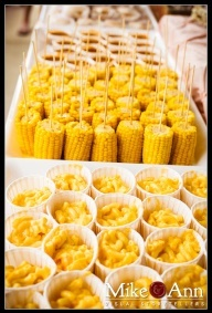 fun kid food for a party Half corn on con for Rs 3rd bday. Made earlier and kept in warmer. Tossed with small amount of butter before serving. Great for large quantities.