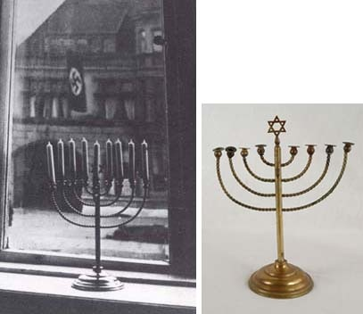 """Hanukkah Menorah from Kiel, Germany  The Posner family left Germany in 1933 and arrived in Eretz Israel in 1934.  On the back of this photograph, Rachel Posner wrote:    """"Death to Judah""""  So the flag says  """"Judah will live forever""""  So the light answers  Research into the photo, conducted in preparation for the opening of the Holocaust History Museum, traced the Posner family who agreed to loan the Hanukkah Menorah (which they still light every year) to Yad Vashem."""