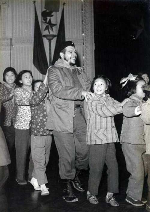 Che Guevara in a conga line in a kindergarten in Shanghai, 1960.