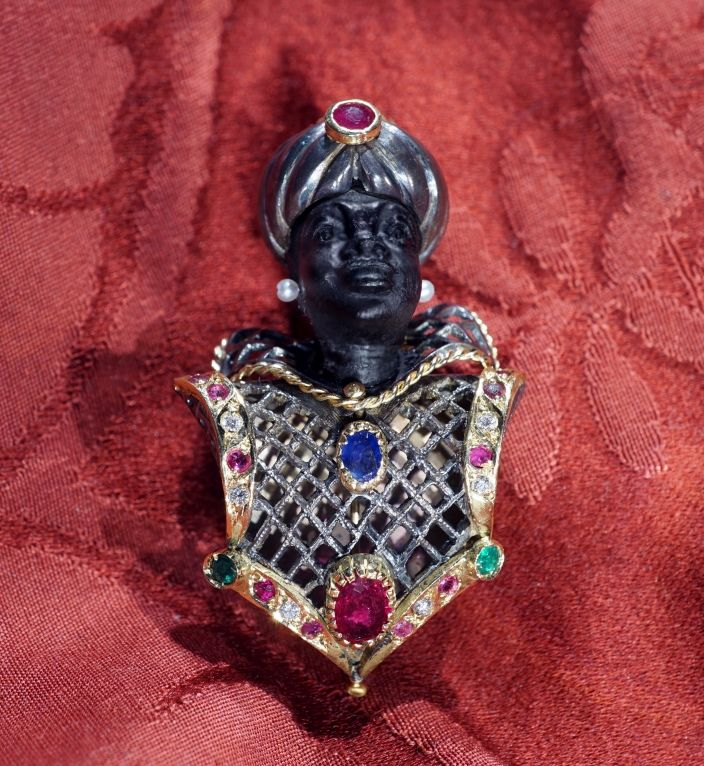 Vintage 1950 blackamoor pierce brooche.  Handmade in Venice,  pierce work, period 1950 circa, dimensions cm 5,5 – Head in ebony replaced on 1995 – yellow gold 18 kt and silver 800 – precious stones: rubies, diamonds, emeralds, sapphire, opal on turban. DOGALE Jewellery Venice Italy