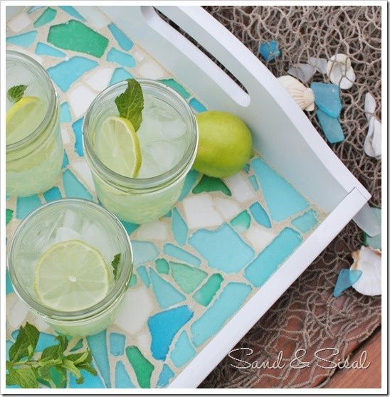 DIY Sea Glass Mosaic Tray - this thrift store tray makeover with all the shades of turquoise, green, and blue seaglass is so pretty and easy to make. Click for a step by step tutorial.