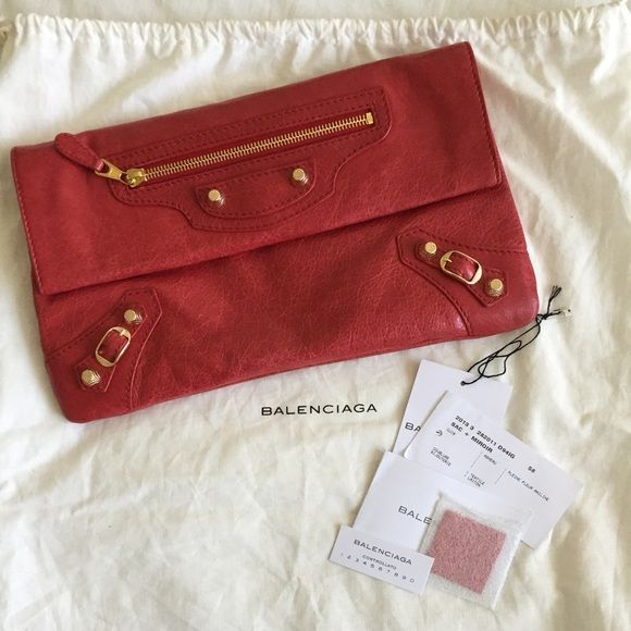 Balenciaga clutch red with gold hard wear Red authentic Balenciaga clutch. Purchased in Toronto jan 2015 and used once. Balenciaga Bags Clutches & Wristlets