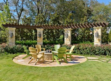 Curved Pergola Design, round patio and firepit.  Iron outdoor lighting, adirondak chairs. This is the general look I desire for our Patio but to make it into a natural courtyard surrounded by trees, shrubs and flowers.