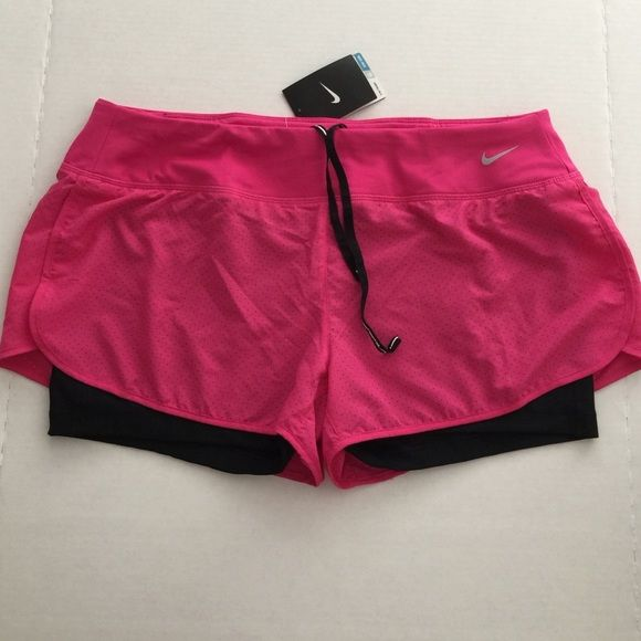 Woman's Nike SHORTS  BNWTG size XL Nike shorts 2 in 1 size XL/body/corps100%polyester-waistline //prettina:86% polyester - 14% spandex / zipper pocket on waistline in back/ Grey swoosh/ top not included;)AUTHENTIC Nike Shorts
