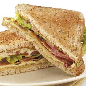 "Pesto BLTs Recipe -""I first tasted this delicious combination in a local bistro,"" recalls Robyn Larabee. She's been making the hefty sandwiches ever since at home in Lucknow, Onatario. It's a tasty way to use up those last, languishing garden tomatoes! TIP: Robyn says her BLTs are especially good served on rustic, homemade whole wheat-and-honey bread."
