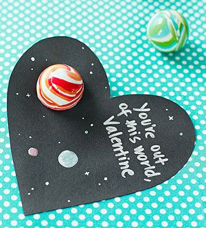 Have a Ball: This sugar-free card incorporates a bouncy ball for extra fun. Cut a large heart out of black or dark blue card stock. Use a craft knife (adults only) to cut a circle that's slightly smaller than the ball. (Tip: Make holes in scrap paper until you get the right size for your ball, then use that hole as a template.) Add stars and planets and your message with a gel pen. Insert the ball; it should fit tightly and stay in place.