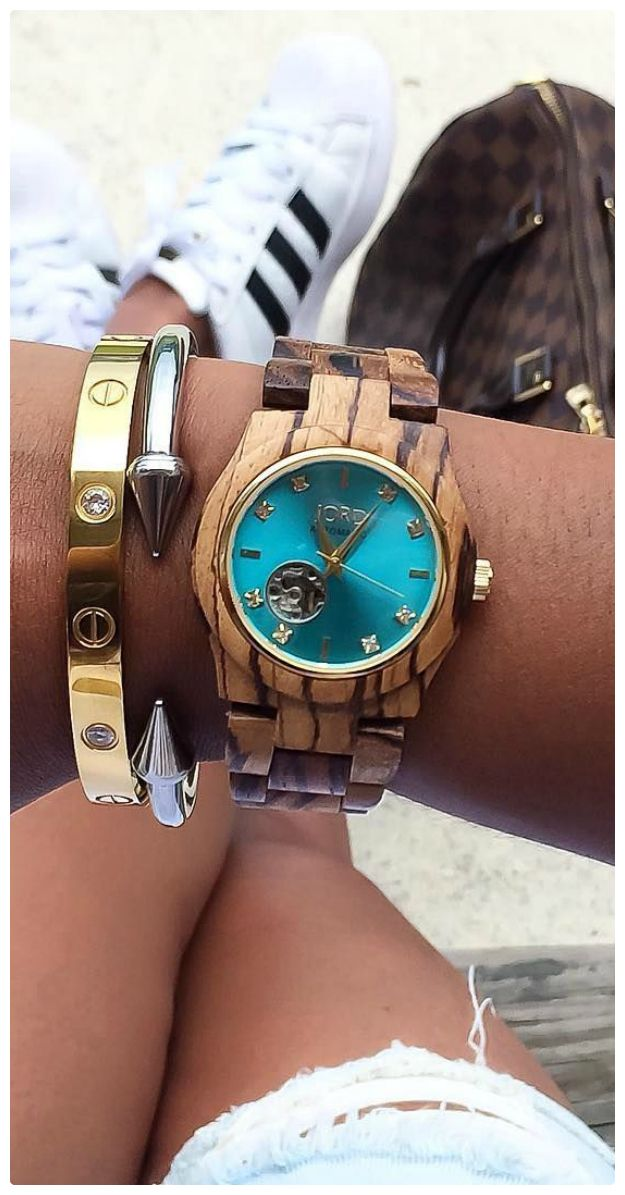 Turnt on turquoise, someone knows how to accessorize! Thank you to @erwinasland for the pic. Featured watch: Cora Zebrawood & Turquoise, our premiere women's automatic watch.