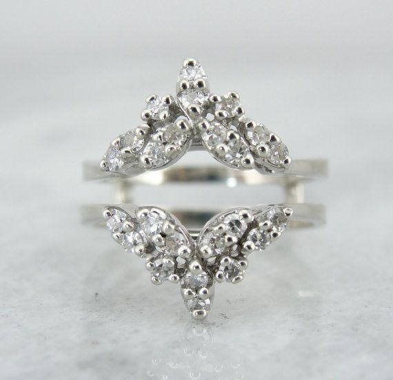 Something kind of like this. Vintage Engagement Ring Enhancer, Wrap, Gaurd, Jacket, Bright White Gold, Diamonds RGDI3048P