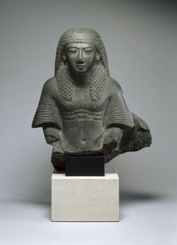 Carved granodiorite male bust from a group statue.  New Kingdom. Late 18th-19th dynasty, c. 1300-1290 B.C.E.