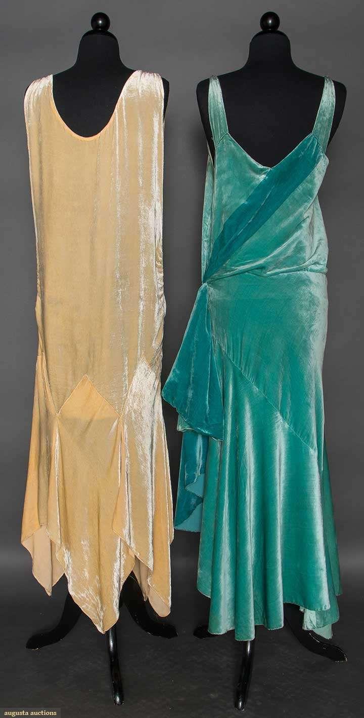 TWO SILK VELVET EVENING GOWNS, 1928-1932 (back views) Both sleeveless, low necklines: 1 aqua, bias cut skirt w/ uneven hem lengths, left hip sash, attached silk charmeuse slip; 1 cream, below hip bias cut skirt w/ handkerchief hem skirt