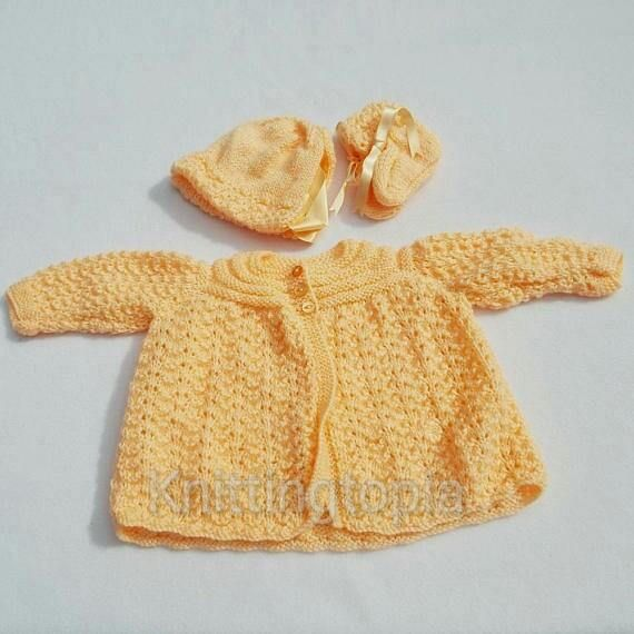 Hand knitted baby cardigan bonnet and booties to fit 12 months - peach - matinée £20.00